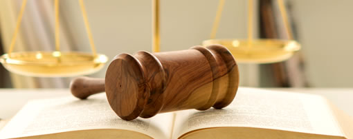 lawbook, gavel and scales