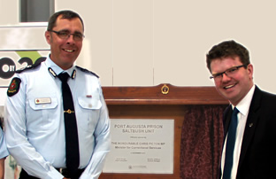 the CE and minister of DCS opening a plaque